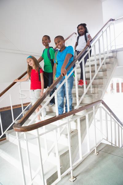 Cute élèves souriant caméra marche vers le bas Photo stock © wavebreak_media