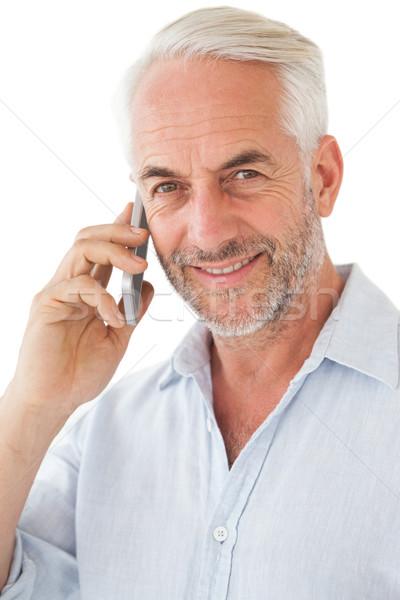 Lächelnd reifer Mann Handy weiß männlich Lifestyle Stock foto © wavebreak_media