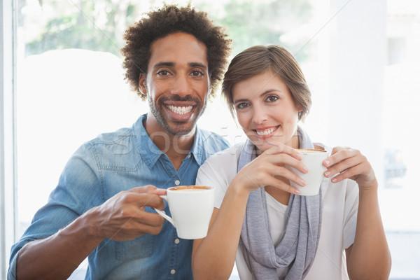 Casual couple having coffee together Stock photo © wavebreak_media