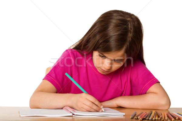 Cute pupil working at her desk Stock photo © wavebreak_media