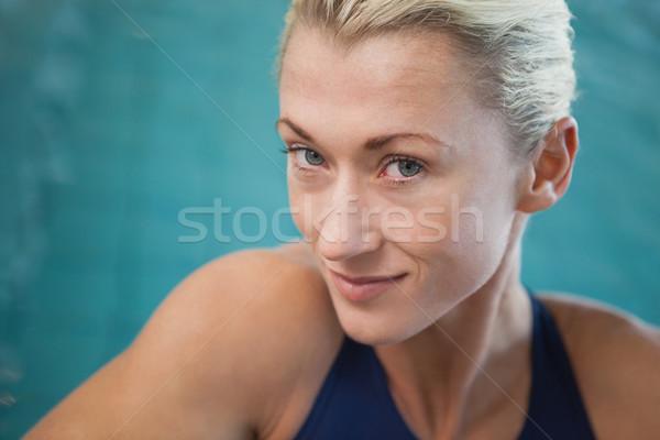 Close-up portrait of a female swimmer by pool Stock photo © wavebreak_media