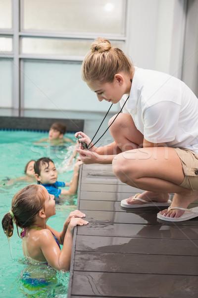 Bastante natación entrenador nino tiempo Foto stock © wavebreak_media