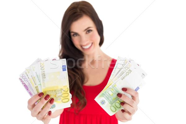 Cheerful brunette showing her cash money  Stock photo © wavebreak_media