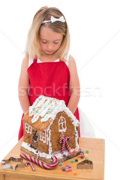 Festive little girl making gingerbread house Stock photo © wavebreak_media