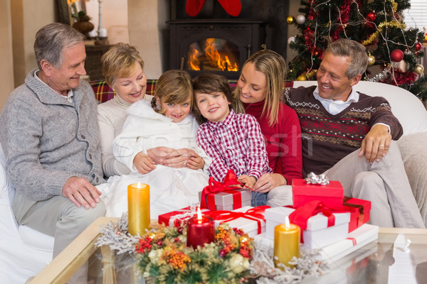 Multi generation family sitting on a couch during christmas Stock photo © wavebreak_media