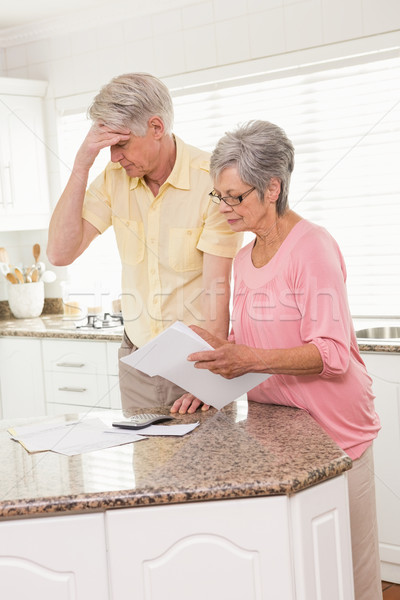 Senior couple paying their bills Stock photo © wavebreak_media