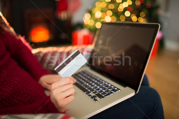 Woman shopping online with laptop at christmas Stock photo © wavebreak_media