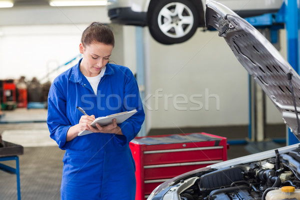 Mechanic examining under hood of car Stock photo © wavebreak_media