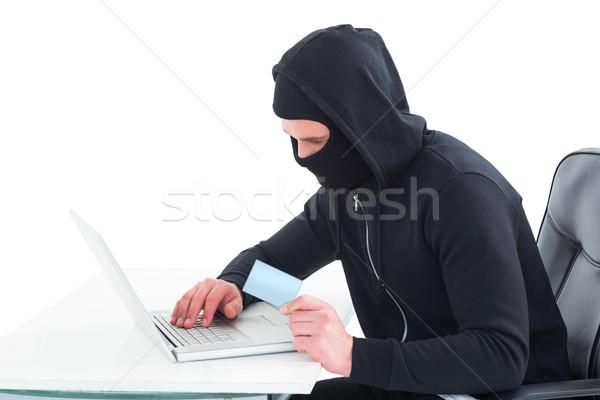 Stock fotó: Hacker · laptopot · használ · hitelkártya · fehér · technológia · notebook