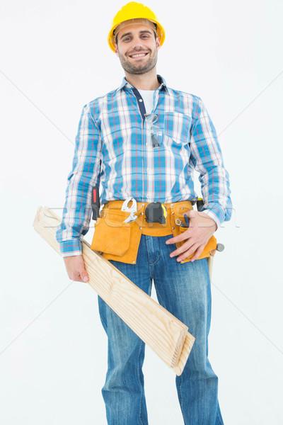 Mosolyog építőmunkás tart fából készült deszkák portré Stock fotó © wavebreak_media