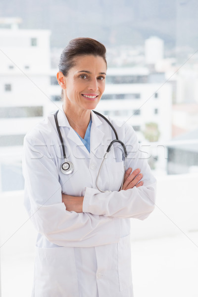 Doctor with stethoscope and arms crossed Stock photo © wavebreak_media