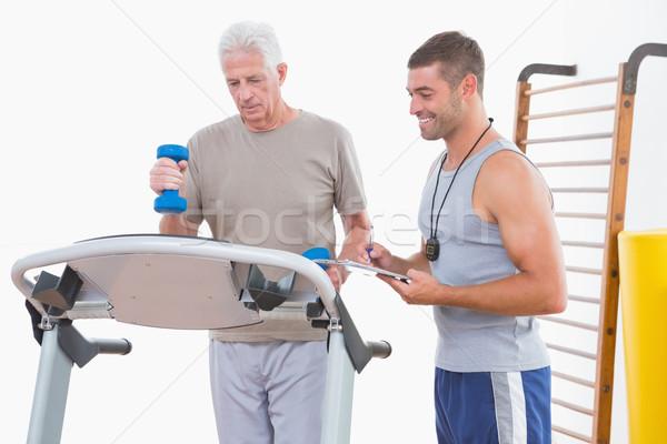 Senior man on treadmill with trainer  Stock photo © wavebreak_media