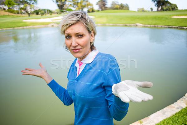Confusi femminile golfista guardando lago Foto d'archivio © wavebreak_media