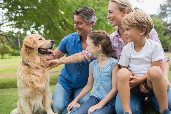 Happy family in the park with their dog Stock photo © wavebreak_media