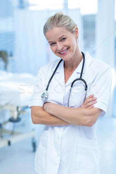 Beautiful smiling doctor standing arms crossed Stock photo © wavebreak_media