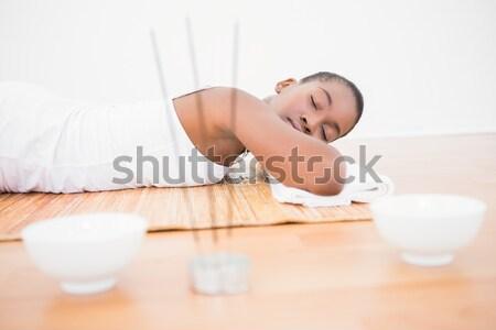 Peaceful pretty woman lying a bamboo mat  Stock photo © wavebreak_media