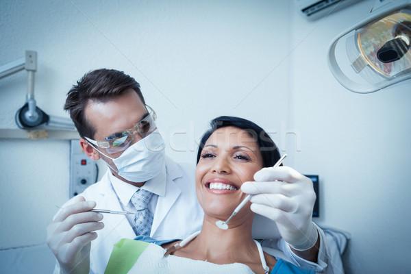 Masculina dentista examinar dientes dentistas silla Foto stock © wavebreak_media