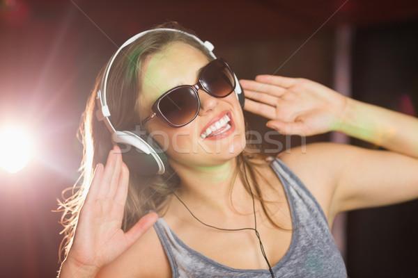 Pretty dj smiling and dancing Stock photo © wavebreak_media