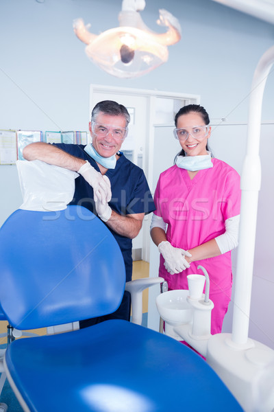 Smiling dentist and assistant with protective glasses Stock photo © wavebreak_media