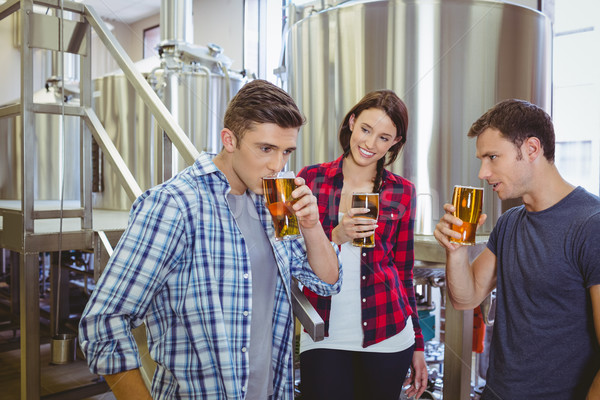 Young hipsters tasting beer together Stock photo © wavebreak_media