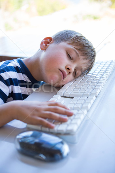 Little boy slipping on keyboard  Stock photo © wavebreak_media