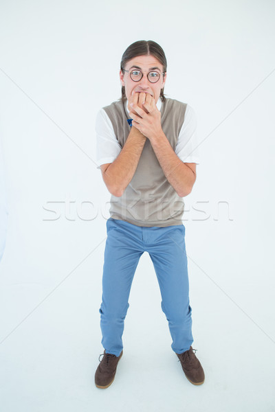 Geeky hipster looking nervously at camera  Stock photo © wavebreak_media