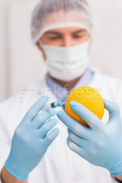Scientifique orange fluide seringue laboratoire Photo stock © wavebreak_media