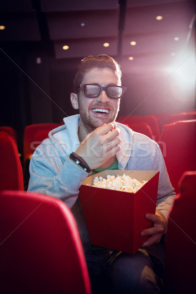 Young man watching a 3d film  Stock photo © wavebreak_media