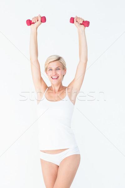 Feliz mulher loira halteres branco saúde Foto stock © wavebreak_media