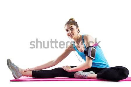 Fit woman stretching on exercise mat Stock photo © wavebreak_media