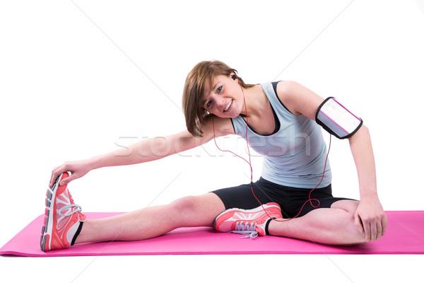 Pretty brunette doing the hamstring stretch on exercise mat Stock photo © wavebreak_media