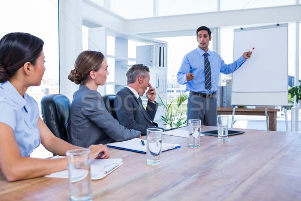 Uomini d'affari parlando riunione ufficio donna uomo Foto d'archivio © wavebreak_media