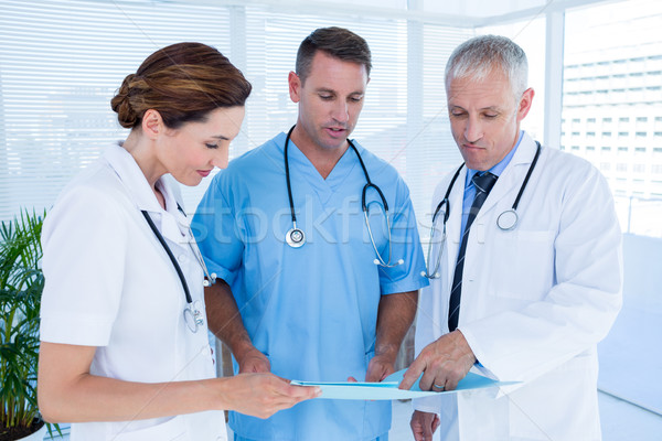 Concentrated medical colleagues analyzing file together Stock photo © wavebreak_media
