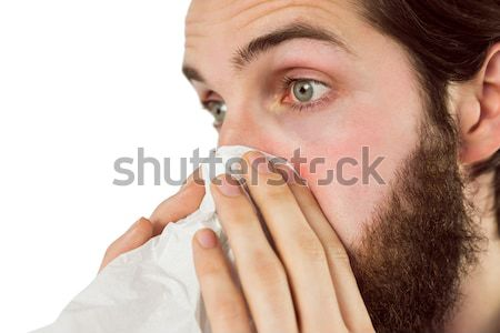 Handsome hipster blowing his nose Stock photo © wavebreak_media