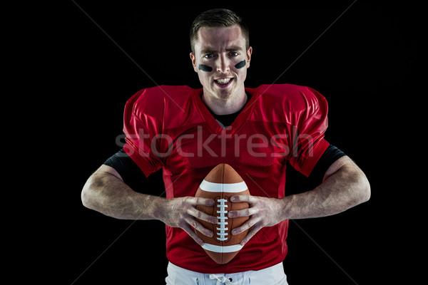 Amerikaanse voetballer bal portret vastbesloten Stockfoto © wavebreak_media