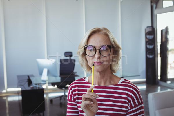 Thoughtful entrepreneur wearing eyeglasses Stock photo © wavebreak_media