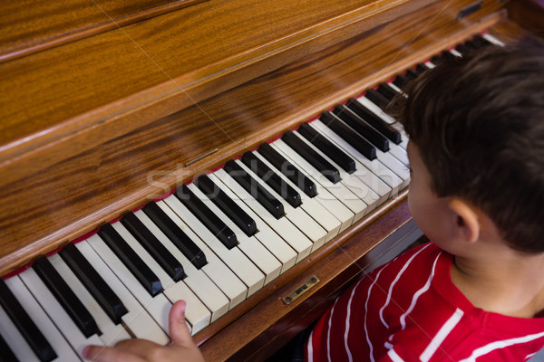 High angle view of boy playing piano in classroom Stock photo © wavebreak_media