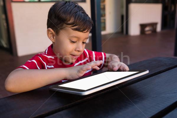 Close up of smiling boy using digital tablet Stock photo © wavebreak_media