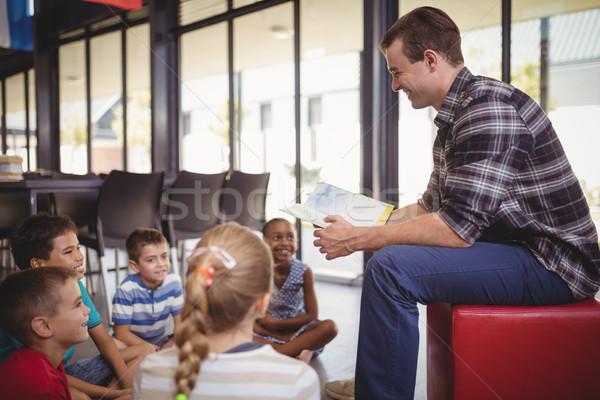 Boldog tanár tanít iskolás gyerekek könyvtár iskola Stock fotó © wavebreak_media