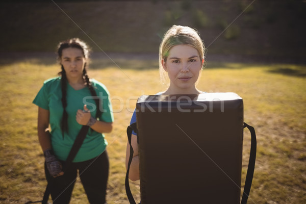 Portrait of women holding boxing equipment during obstacle course Stock photo © wavebreak_media