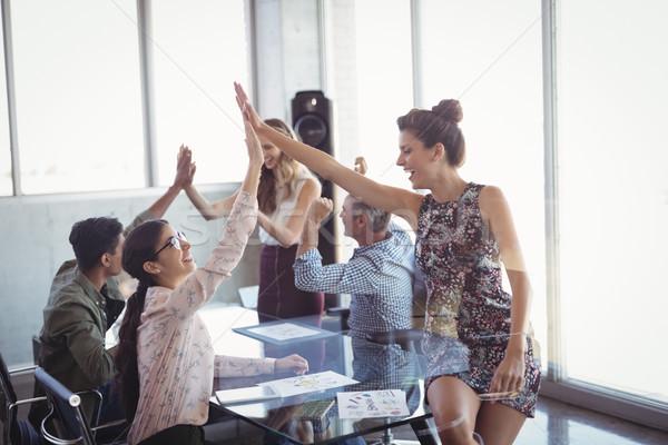 Boldog üzlet pacsi kreatív iroda irodai asztal Stock fotó © wavebreak_media