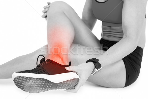 Low section of female sportsperson suffering from ankle pain on white background Stock photo © wavebreak_media