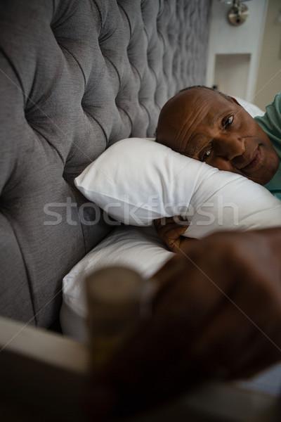 Portrait of senior man resting on bed Stock photo © wavebreak_media