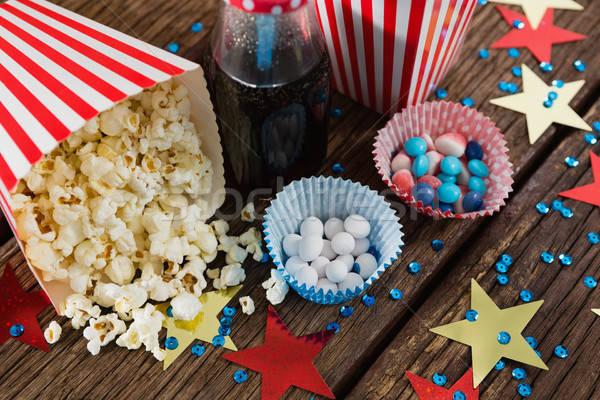 Scattered popcorn and sweet food decorated with 4th july theme Stock photo © wavebreak_media