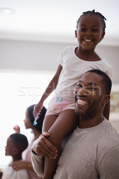 Happy father carrying carrying daughter in bathroom at home Stock photo © wavebreak_media