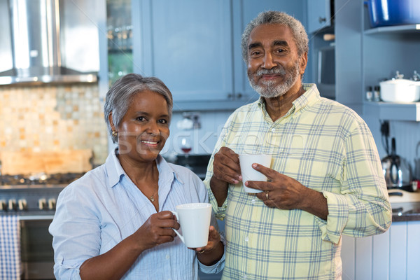Portrait of smiling senior couple with coffee cups Stock photo © wavebreak_media