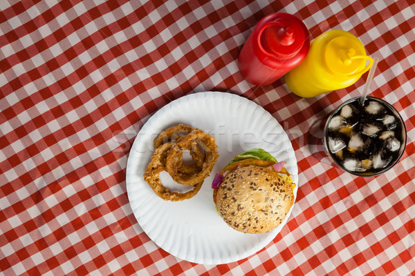гамбургер картофель фри лука кольца холодные напитки салфетку Сток-фото © wavebreak_media