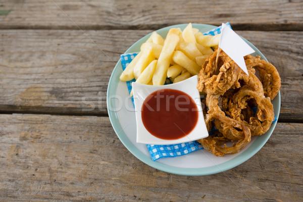 Cipolla anelli patatine fritte servito piatto Foto d'archivio © wavebreak_media