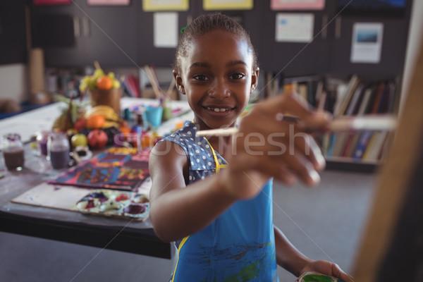 Portret happy girl malarstwo płótnie klasie papieru Zdjęcia stock © wavebreak_media