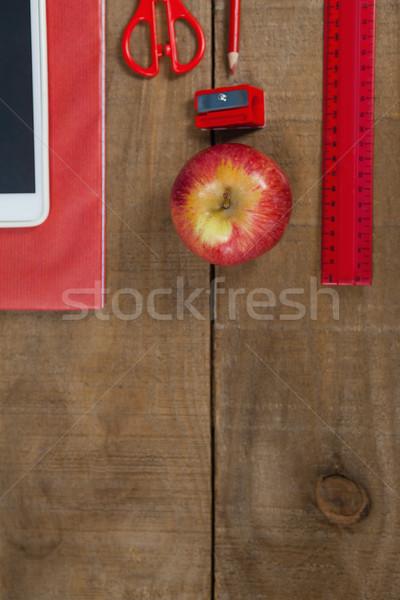 Apple, digital tablet and school supplies on wooden table Stock photo © wavebreak_media